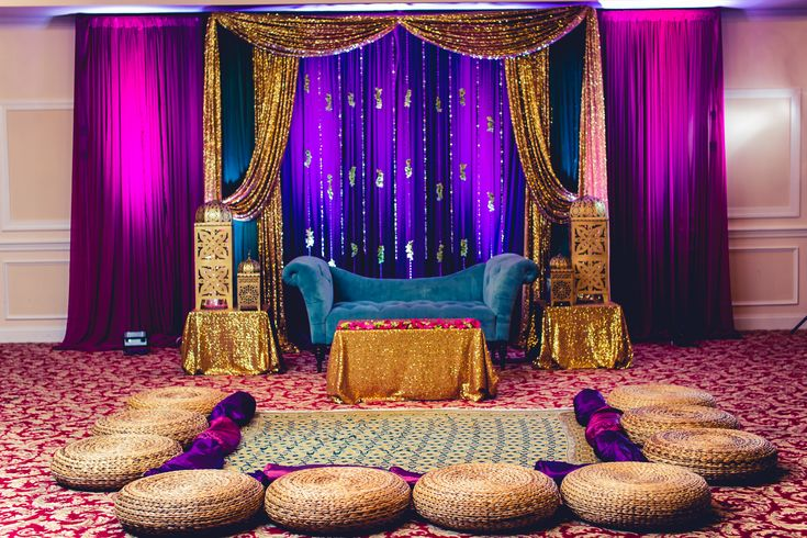 Bold gem tones for the mehndi sangeet dholki stage for Background decoration for indian wedding