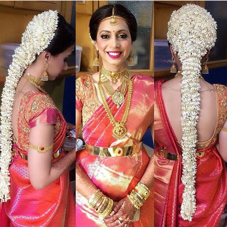 South Indian bride. Gold Indian bridal jewelry.Temple jewelry. Jhumkis.Red pink silk kanchipuram sari.Side braid with fresh jasmine flowers. Tamil bride. Telugu bride. Kannada bride. Hindu bride. Malayalee bride.Kerala bride.South Indian wedding.