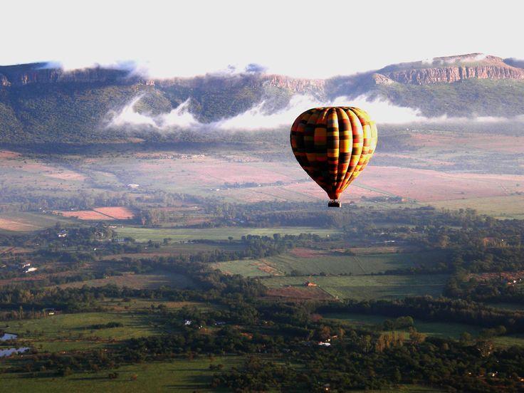 """""""Sip fine champagne while hovering gently above the tree tops of the beautiful Magalies River Valley. Or drift majestically high above the Magaliesberg range in the Cradle of Humankind World...#magaliesberg #hotairballoon #billharrops"""