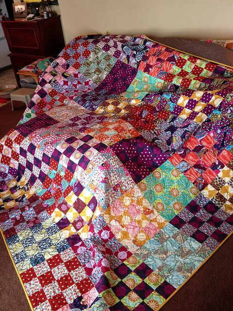 """Cut 2 fat quarters into quarters.  Sew strips And cut. Blocks can be 4x4"""". 16 blocks makes 1 large square"""
