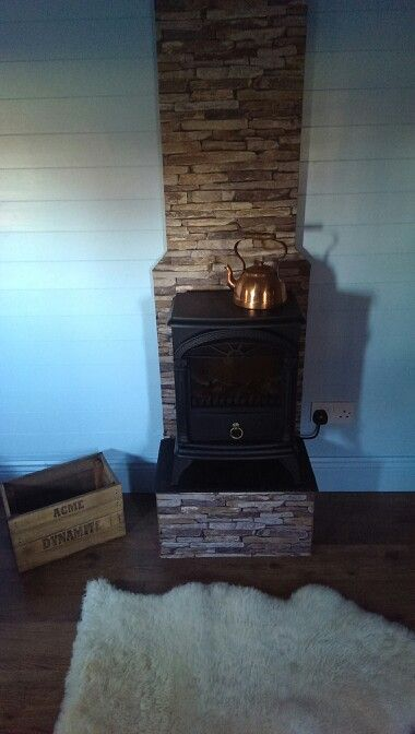 Boys playhouse, ranch style.. this was so fun to do and looks perfect in the house.. again, i made the dynamite box and used a fab brick effect wall paper to do the fire place.. got all the accessories at a car boot sale..