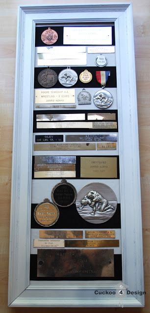 Great space saving idea for displaying all those old trophies & medals!