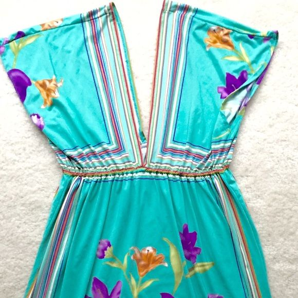 Floral Beach Resort Dress I have worn this as a swimsuit cover up and as a dress with a cami underneath. It's a beautiful combination of blue, orange, purple and green Dresses