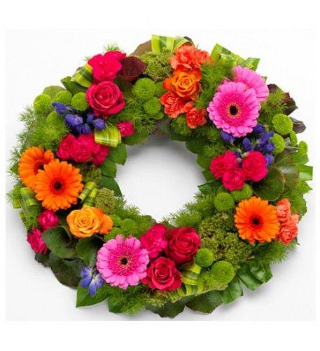 This arrangement contains the following flowers: Cerise Roses Orange Roses Cerise Carnations Orange Germini Purple Anconitum Green spray Chyrsanthemums.