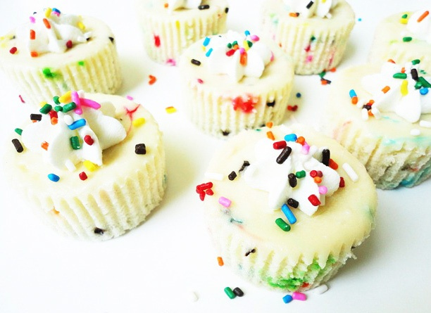Mini Funfetti Cake Batter Cheesecakes - SO YUMMY! If you can manage to not eat all the batter before baking it. And the Golden Oreo makes the perfect crust for these little concoctions.
