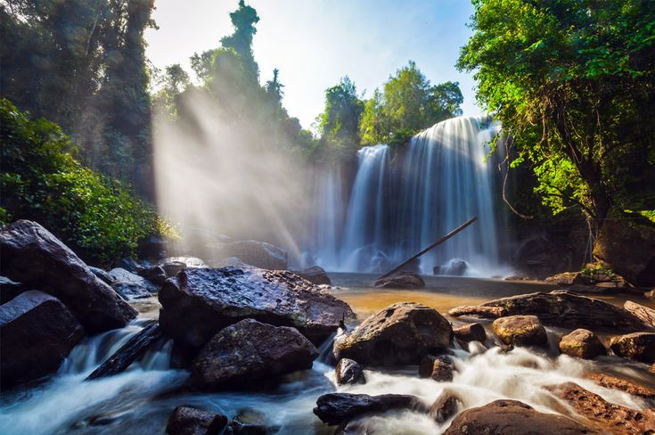 """Fly to Siem Reap to enjoy the Natural beauty of Phnom Kulen waterfall, located in Phnom Kulen National Park. The waterfall is the park's main tourist attraction. Phnom Kulen or Kulen Mountain means """"Mountain of Lychees"""" considered to be the most sacred mountain by Khmers."""