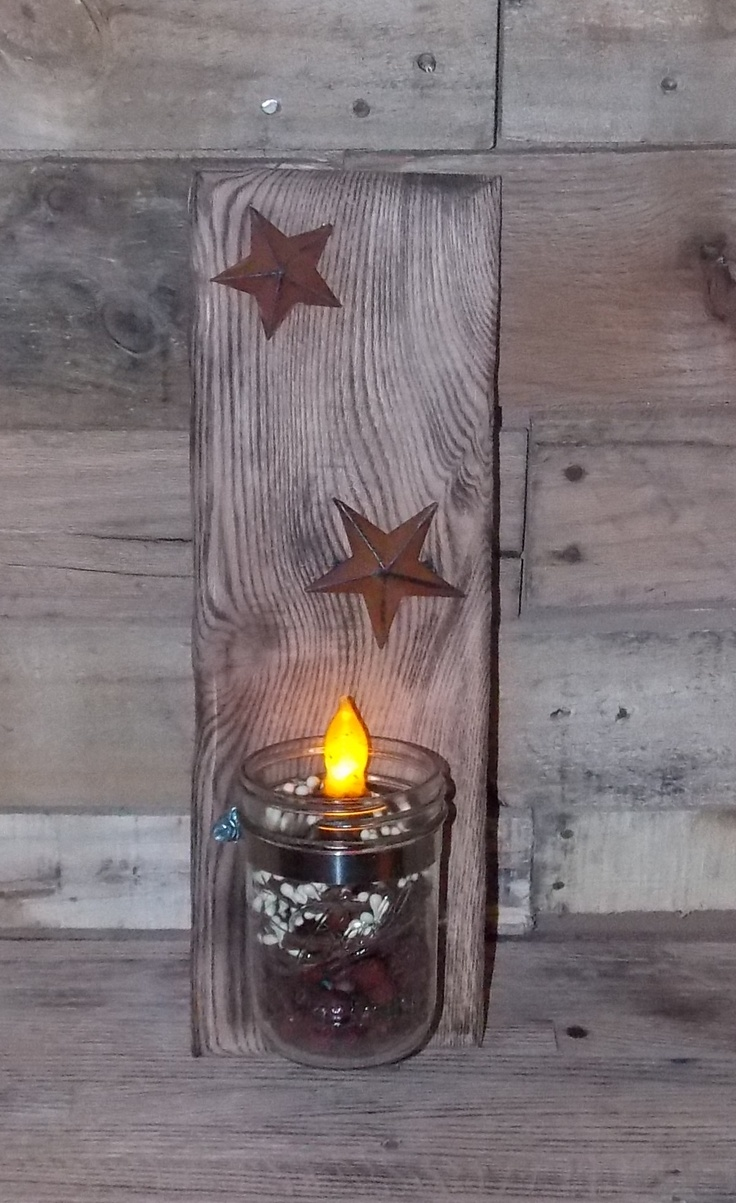 Beautiful piece of recycled wood that we burnt. We attached some rustic stars & the mason jar which is filled with cookie scented primitive potpourri & a primitive looking candle. In addition to that I put some of the berry garland with rust stars around the inside of the jar. This item is currently for sale for $20.00 please check out other items that my husband and I have made over at Rustic Creations https://www.facebook.com/rusticcreations12
