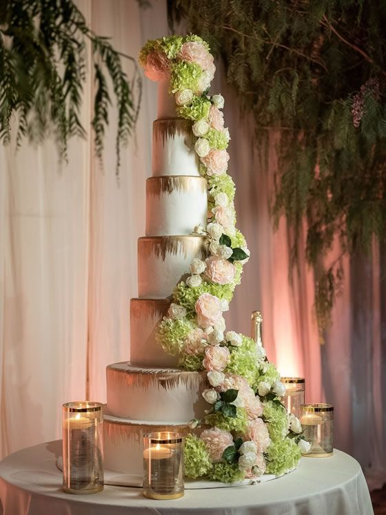 Gorgeous Cake Alert Seven Tiered Wedding Cake Is Decorated With Gold Leaf And A Lavish