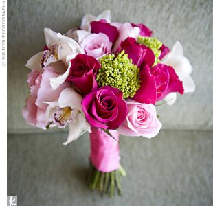 Bouquet made up of light and dark pink roses tied together with pink ribbon.