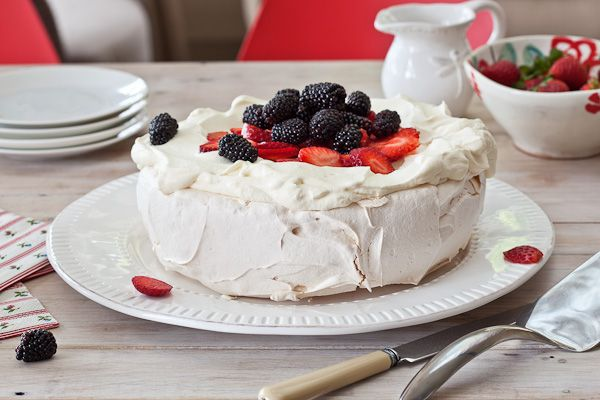 The most perfect pavlova says exactly what this is.  In summer use berries and in winter try lemon curd or sliced kiwifruit.