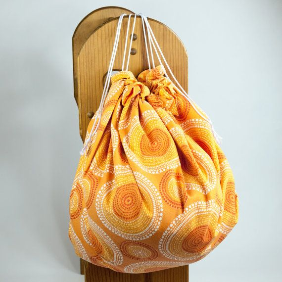 This pattern has large orange, yellow and white swirls over orange background on front side and smaller swirls of orange and yellow on back side. Machine wash and dry. #etsy #legos #mat #sack #kids #children #toys #drawstring #play