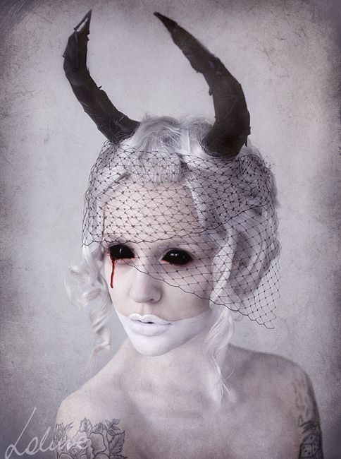 A special effect makeup idea featuring pale white skin, white lipstick, light-grey hair, black  prosthetic horns, and black demon contacts => http://www.pinterest.com/pin/350717889705707881/