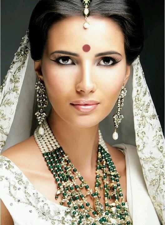 woman, dark hair, eyes, brown, black, tan, India, bride, wedding