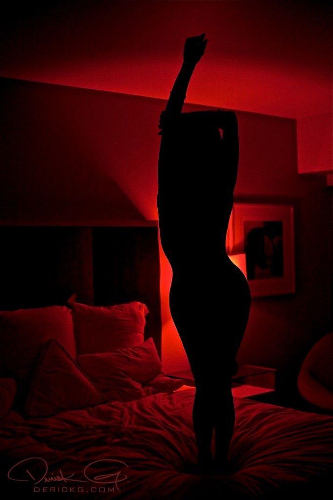 sexy bedroom lighting. the red light seems to be coming from a lamp with cover on it has cone shape expanding as reaches for ceiling sexy bedroom lighting