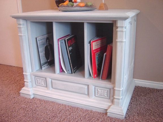 This is an old TV console turned into a sheet music storage unit...I see scarp books here also or use it as a tv stand