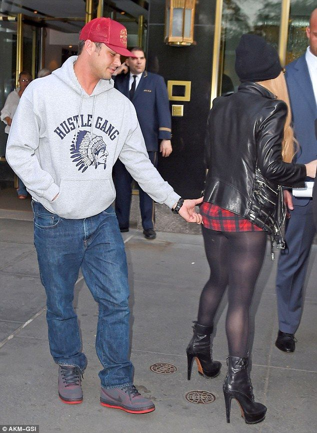 That's cheeky! Gaga's boyfriend Taylor Kinney was seen pinching her bottom as she spoke with her bodyguards