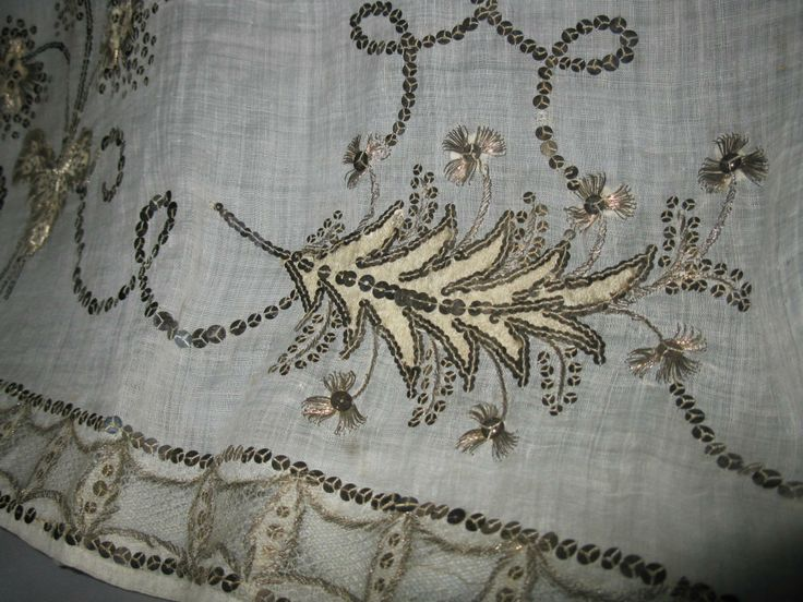 FORTUNEE. Detail of embroidery. Real silver paillettes, cannetille, ivory satin & real silver thread. The dress is made from linen batiste, France, 1796-98. Napoleon and the Empire of Fashion
