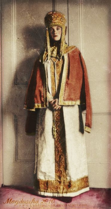 Grand Duchess Olga Nikolaevna of Russia, probably in a traditional Russian robe.