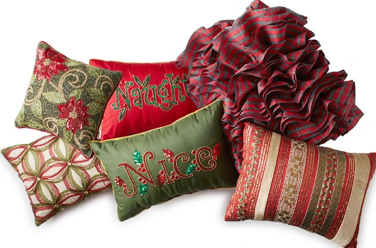 Assorted Pier 1 holiday pillows include Tartan Ribbon, Plaid Flounce and Naughty and Nice Reversible Pillows