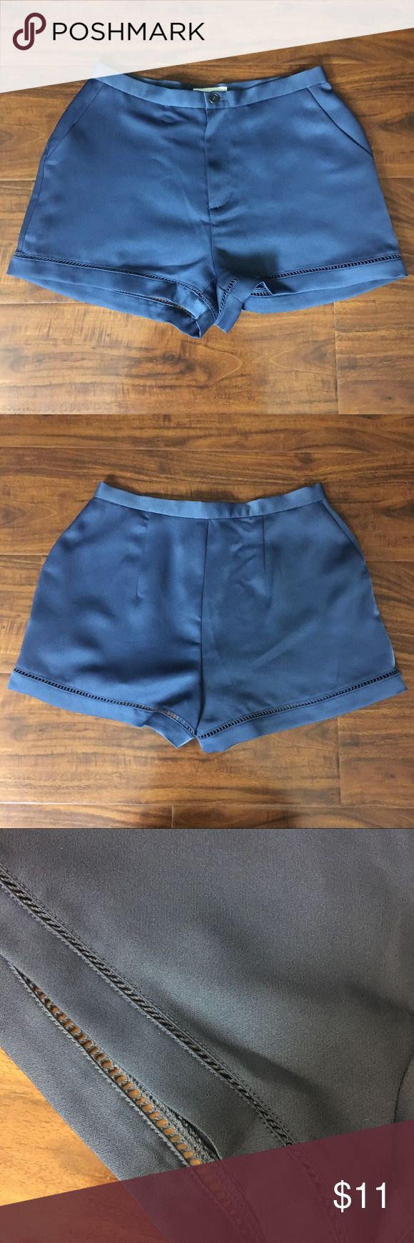 NWOT Urban Outfitters Navy Shorts Size 2 Smoke free home. Size 2. Material is 100% polyester but it has that silk look and feel. Very cute and comfty. Urban Outfitters. Has little holes in the edges. Never worn before but does not have the tags. Perfect condition. Urban Outfitters Shorts