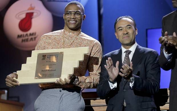 OKC's Russell Westbrook, left, holds up a plaque awarded to him by NBA Deputy Commissioner Mark Tatum as the Community Assist Award winner, during the NBA Draft Lottery on Tuesday, in New York.                     AP Photo