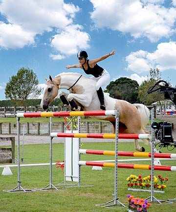Alycia Burton and her amazing horse Classic Goldrush jump 6ft and above with no saddle or bridle. All there is on the horse is a free rein which wraps around the horse's neck so she can turn her horse more easily. There is an amazing bond between Alycia and Goldrush.