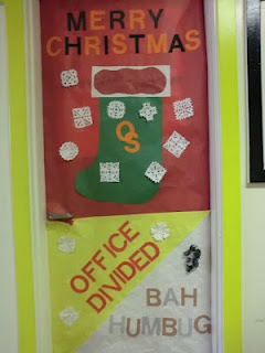 """A hallway door decorating contest (or """"Door Wars"""" with a college theme spurs competition and education. This one from Coffenberry Middle School had a holiday twist!"""