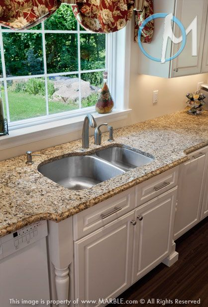 This double bowl sink is surround with Brasil Gold granite. Ogee edging and a stylish bumpout compliment the classic look beautifully.