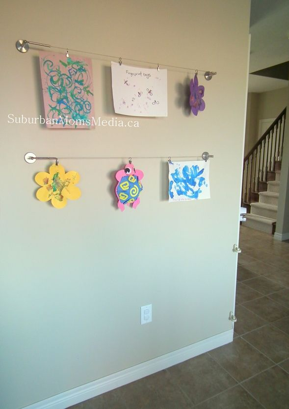 Neatly display children's artwork with Ikea dignitet curtain wires