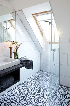 Funky monochrome patterned floor tiles really bring this modern bathroom alive!