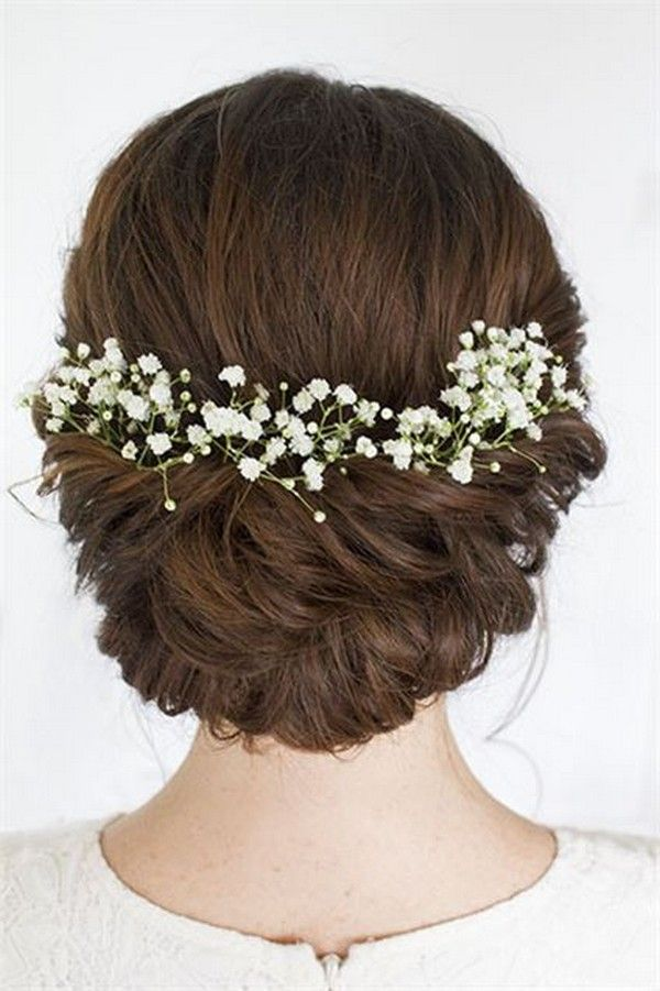 Soft romantic bridal wedding hair decorated with baby's breath