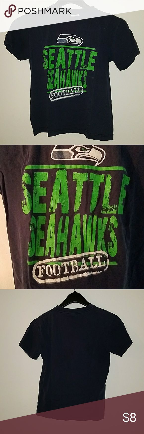 Seahawks Size M (8) Kids T-shirt Seahawks Size M (8) Kids T-shirt.  Has been worn but LOTS of life in this t-shirt.  GO HAWKS! NFL Shirts & Tops