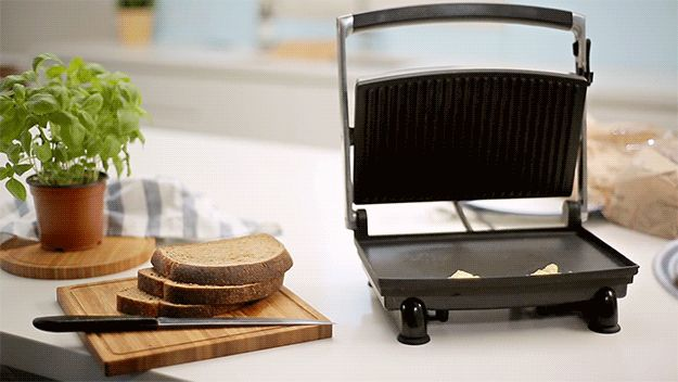 Heat a wet paper towel in a sandwich press for a couple of seconds to clean off crusty cheese.