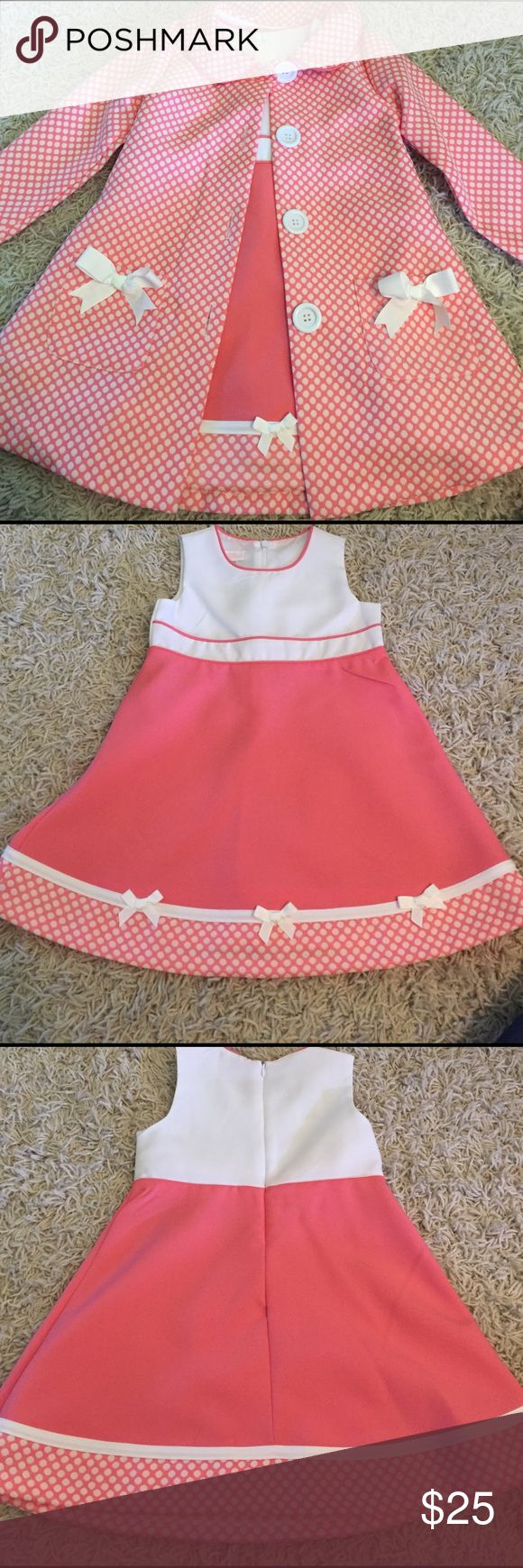 Coral toddler Easter dress with jacket Coral and white dress with polka fits at the bottom. Zipper in back of dress. Matching polka dot jacket to accessorize with dress! Perfect dress for Easter or spring! Brand new! Dresses Formal