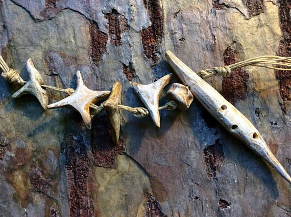 Fish Bone Fossils, Handmade ceramic beads. My Fossil Ocean Series was inspired from a collection of fossils collected in southern Minnesota. I love the earthy weathered sandstone colors in this series. I decided to make these after having to sit on a dusty garage floor to pick up hundreds of fossils. I accidentally spilled my bucket of fossils while cleaning. The process of picking all them up made me want to share them with you in the form of earthy beads. I love them