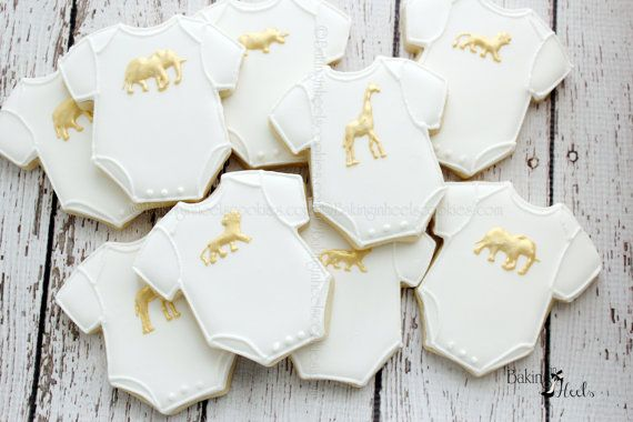 Listing is for one dozen (12) Gold Animal Baby Onesie Cookies  Cookies are approximately 3.35  **Cookies are accented with edible Gold luster dust  DATE NEEDED: Please leave your event date in note to seller during checkout. ****************************************************************************** CUSTOM LISTING: If you need additional cookies please convo me and I would be glad to put up a special listing for you. Each cookie is heat sealed in a clear cello bag and tied with…