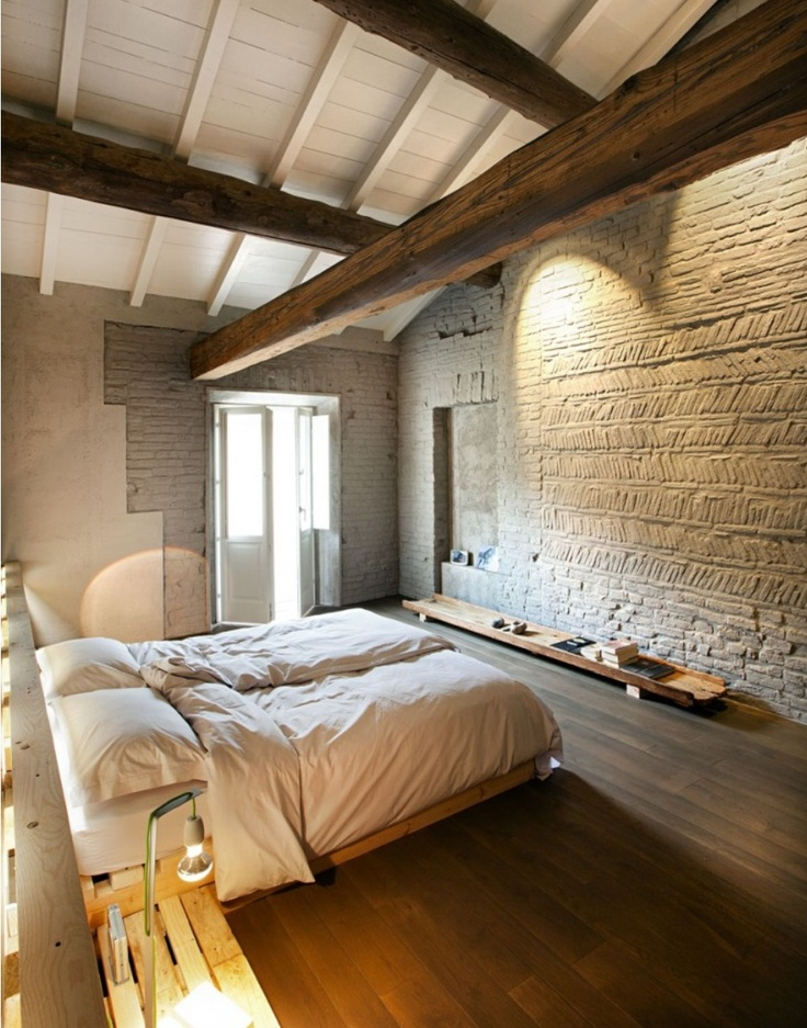 Glowing Italian Country Style Bedroom with Rough Plastered Walls and Exposed Beams