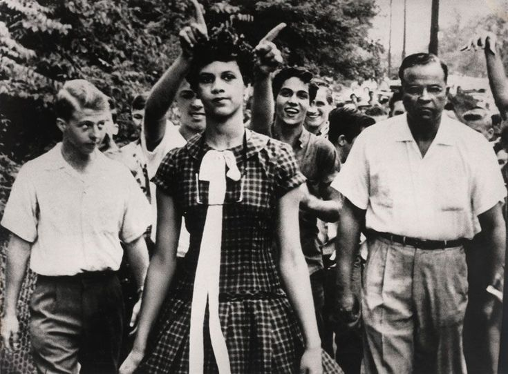 "1957. Dorothy Counts, one of the first black students to enter the newly desegregated Harry Harding High School is mocked by whites on her first day of school. People threw rocks and screamed at her ""Go back where you came from"". After a string of abuses, Dorothy's family withdrew her from the school after only four days. (Douglas Martin, USA)"
