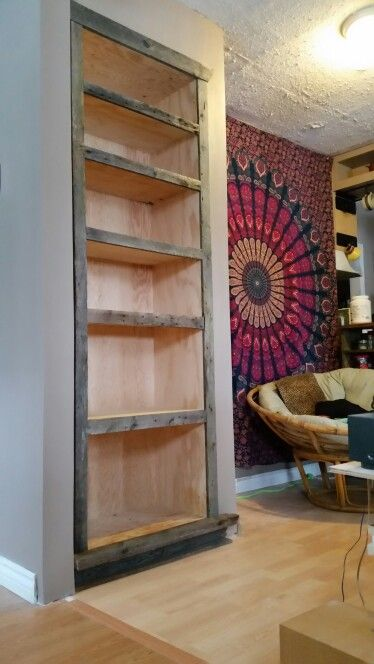 This #bookcase used to be an extra closet. #reused #barnboard trim.