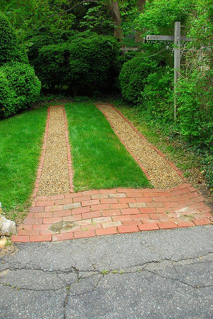 cute brick and pea gravel ribbon driveway