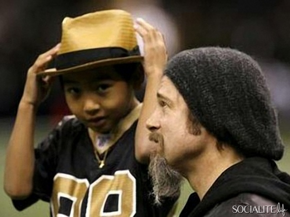 Brad Pitt and Maddox take in a New Orleans Saints game