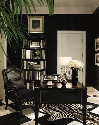 Chic Home Office; dramatic black and white floor and decor  This room is great because accessories of a bright color can alternate throughout the year.  Also reminds me of old Hollywood Glam....Needs a mirror desk though.