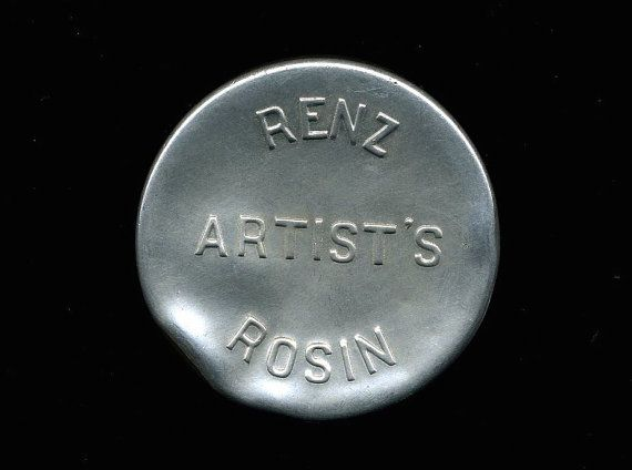 An antique tin case for violin rosin. Cover label is stamped, Renz Artists Rosin. Rare!    Case is in good condition with a few dings here and