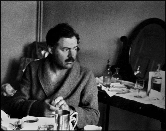 Robert Capa: December 1937, writer and journalist Ernest Hemingway takes breakfast in his hotel in Valencia, which he used as a base during the Spanish Civil War.