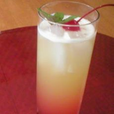 Sweet Seduction (1 oz malibu rum 1 oz banana liqueur 1/2 cup pineapple juice 1 cube ice 1 tbsp grenadine)