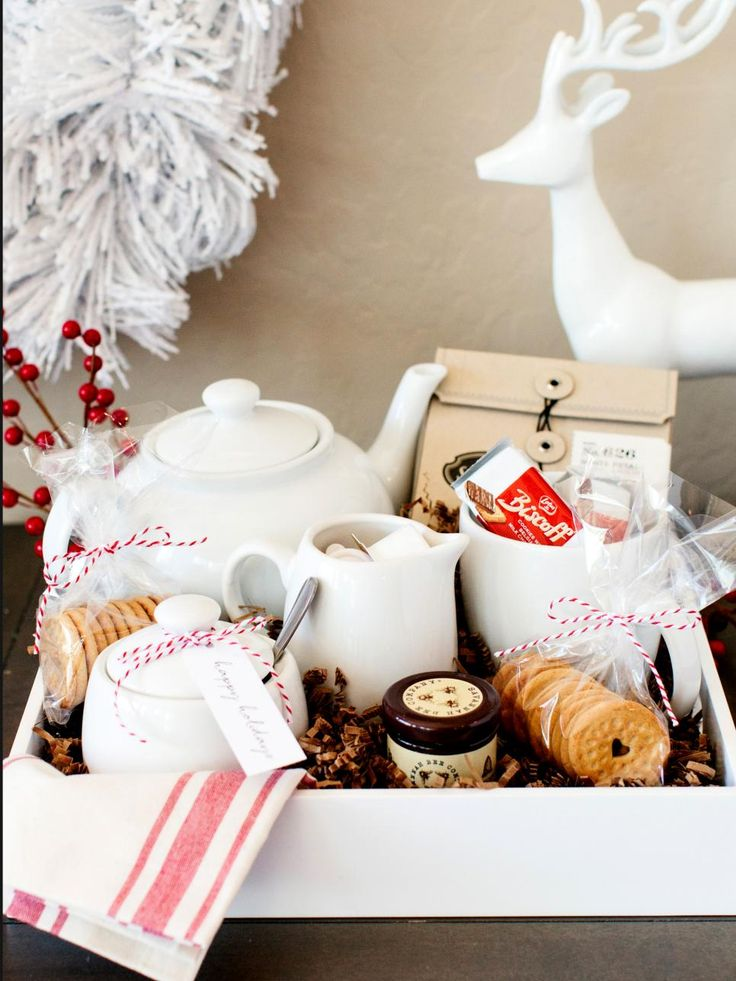 This tray is perfect for any tea lover. Start with a nice tray and fill with favorite tea flavors. A classic ceramic tea set is a beautiful addition to this gift idea. Don't forget to add honey, sugar and cream along with treat perfect for an afternoon tea. Add a tea towel and a simple holiday gift tag for a decorative touch.