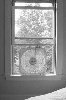 Square fan in window during summer, no air conditioning. My Dad strategically placed them so air would flow through the house.