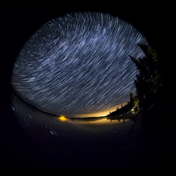 Tips for photographing star trails at night from shooting to stacking and blending.