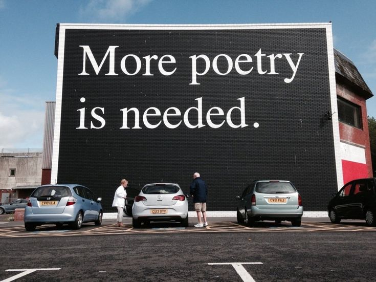 """bookmania:  A huge print in black and white, 'More Poetry Is Needed' sits on the wall of a shopping centre in Swansea, United Kingdom. The wall art greets the city centre goers, allowing them to appriciate the idea that """"Everybody and everywhere could do with more poetry."""""""