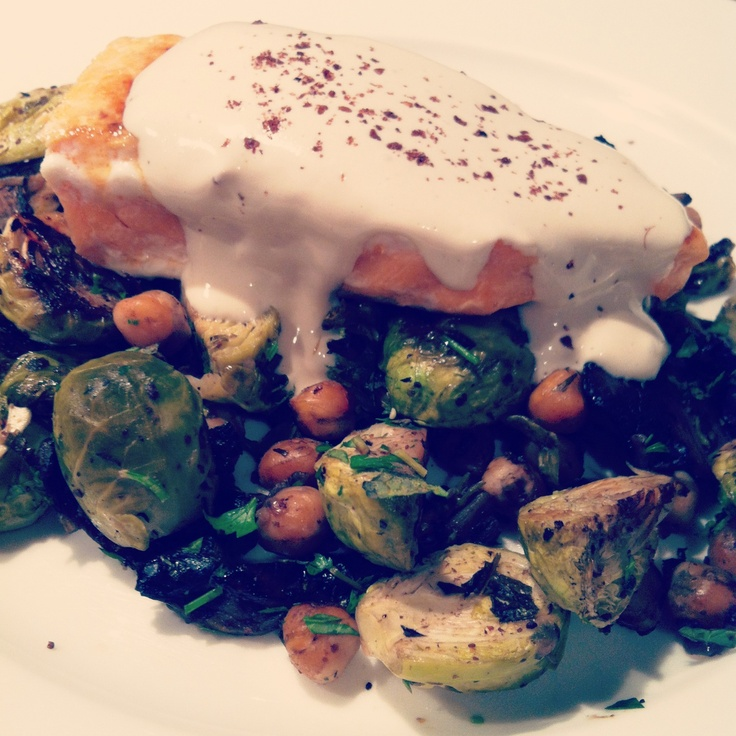 Salmon on a warm spiced salad of brussel sprouts, mushrooms and chickpeas. Topped with tahini sauce.